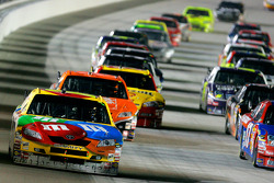 Kyle Busch leads a group of cars
