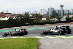Romain Grosjean, Lotus F1 E23 leads Sergio Perez, Sahara Force India F1 VJM08