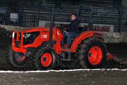 Tony Stewart does some track maintenance