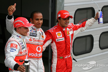 Pole winner Lewis Hamilton with Felipe Massa and Heikki Kovalainen