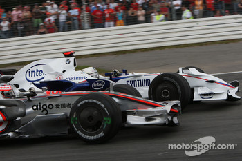 Heikki Kovalainen, McLaren Mercedes and Nick Heidfeld, BMW Sauber F1 Team