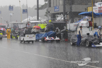 The pit lane during the rain shower before the race