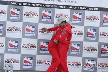 Podium: race winner Ryan Briscoe celebrates with Helio Castroneves