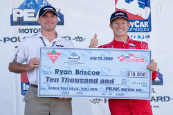 Pole winner Ryan Briscoe accepts his pole award check