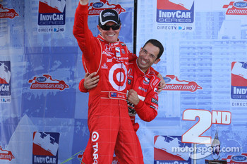 Race winner Scott Dixon celebrates with Helio Castroneves