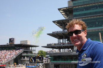Honorary Starter, actor John McGinley of Scrubs, poses from the starter stand as balloons are launched just prior to start the Allstate 400 At The Brickyard