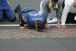 Jimmie Johnson kisses the bricks