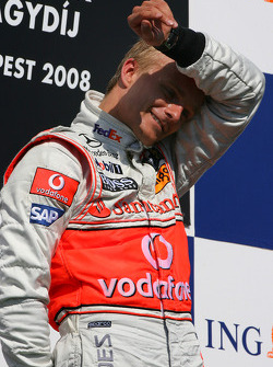 Podium: race winner Heikki Kovalainen