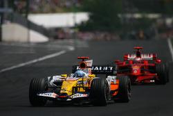Fernando Alonso, Renault F1 Team, R28 and Kimi Raikkonen, Scuderia Ferrari, F2008