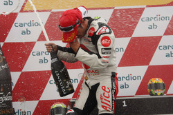 Podium: Champagne for Toni Elias