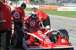 Scott Dixon getting in his car