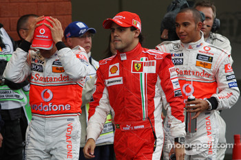 Pole winner Lewis Hamilton, McLaren Mercedes, second place Felipe Massa, Scuderia Ferrari, third place Heikki Kovalainen, McLaren Mercedes