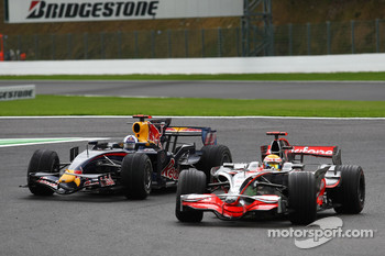 Lewis Hamilton, McLaren Mercedes, MP4-23 passes David Coulthard, Red Bull Racing, RB4