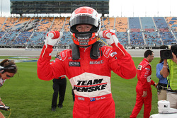Pole winner Ryan Briscoe celebrates
