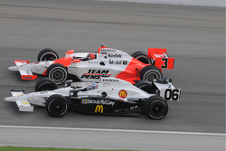 Graham Rahal and Helio Castroneves run together