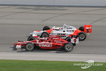 Scott Dixon and Ryan Briscoe run together