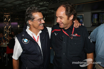 Gerhard Berger celebrates with Dr. Mario Theissen