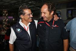 Gerhard Berger celebrates with Dr. Mario Theissen
