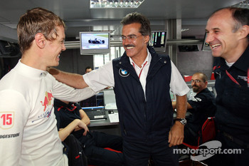 Pole winner Sebastian Vettel celebrates with Dr. Mario Theissen, BMW Sauber F1 Team, BMW Motorsport Director and Franz Tost, Scuderia Toro Rosso, Team Principal