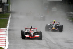 Heikki Kovalainen, McLaren Mercedes, MP4-23 leads Mark Webber, Red Bull Racing, RB4