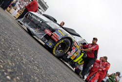 Greg Biffle's crew push his car to tech inspection