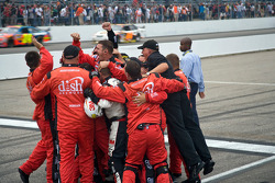 Dish Network crew members celebrate victory