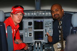 Kimi Raikkonen of Ferrari  flys in an Etihad Airways flight simulator over the Yas Island, the site of the Abu Dhabi Etihad Airways F1 Grand Prix 2009