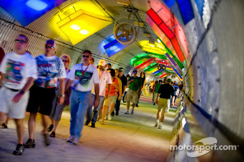 Fans walk through the underground tunnel