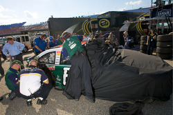 AMP Energy Chevy crew members inspect the damage on the car of Dale Earnhardt Jr.
