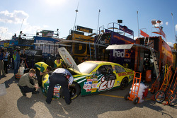 Subway Toyota crew members work on their car after the crash of Tony Stewart