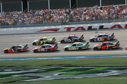 Martin Truex Jr. leads a group of cars