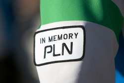 Newman Wachs Racing team members wear a 'In Memory PLN' sign