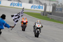 Andrea Dovizioso takes the checkered flag