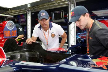 Stock Car drivers Carlos Bueno and Daniel Serra in the Scuderia Toro Rosso garage
