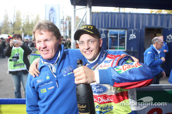 Rally winners Mikko Hirvonen celebrates with Malcolm Wilson