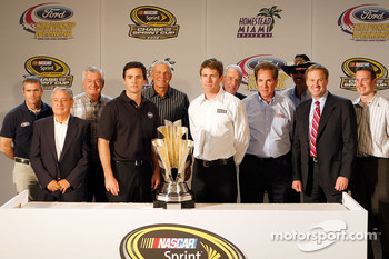 Bobby Labonte, Rex White, Bobby Allison, Jimmie Johnson, Dale Jarrett, Carl Edwards, Ned Jarrett, Darrell Waltrip, Richard Petty, Rusty Wallace and Kurt Busch pose with the NASCAR Sprint Cup Series trophy during the 2008 Championship Contenders Press Conf