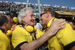 Hugues de Chaunac, Hans Stuck and Seat team members celebrate the WTCC world championship of Yvan Muller