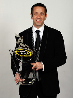 Greg Biffle poses with his award for third place in the NASCAR Sprint Cup Series Chase