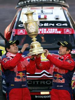 Podium: rally winners Sébastien Loeb and Daniel Elena