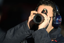 A Scuderia Toro Rosso team member takes photographs