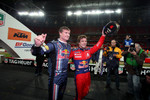Race of Champions winner Sébastien Loeb celebrates with second place David Coulthard