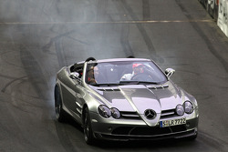 Lewis Hamilton gives his brother Nicholas a ride around the track in the McLaren Mercedes SLR