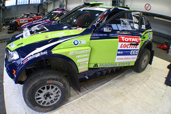 X-raid team: the #330 BMW X3 CC of René Kuipers and Filipe Palmeiro in the garage