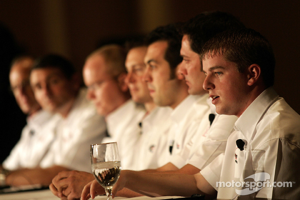 NASCAR Nationwide Series driver Justin Allgaier talks as NASCAR Sprint Cup drivers David Stremme, Sam Hornish Jr. and Kurt Busch along with Penske Racing executives listen