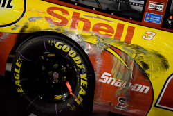Victory lane: Kevin Harvick's Shell/Pennzoil Chevy took a beating before it took the checkered flag