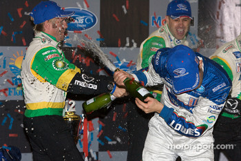 P2 podium: Ben Devlin sprays champagne with two bottles