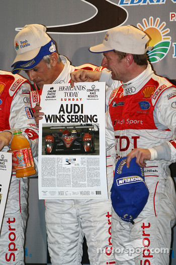 Class winners podium: P1 and overall winners Rinaldo Capello and Allan McNish hold the winners newspaper