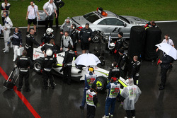 Jenson Button, Brawn GP, on the reformed grid, after the race was red flagged due to rain