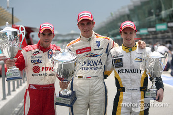 Vitaly Petrov celebrates his victory with Pastor Maldonado and Davide Valsecchi