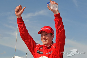 Race winner Ryan Briscoe, Team Penske, celebrates
